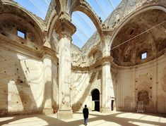 In the old town of Corbera d'Ebre in Tarragona, Spain, Ferran Vizoso Architecture won a competition to transform an old church with a large skylight structure, which became the roof.