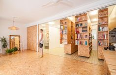 Movable Shelving System Transforms a Single Room into Separate Spaces mymodernmet.com