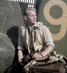 """Hans Henrik """"Hasse"""" Wind (1919-1995) was a Finnish fighter pilot and flying ace in World War II with 75 confirmed air combat victories. He is seen here with his plane in Suulajärvi (1943)"""