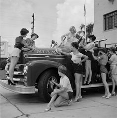 girls at miami fire department, 1955, by bunny yeager