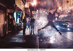 Person dancing in the street in Chinatown, San Francisco, California at night. Stock Photo