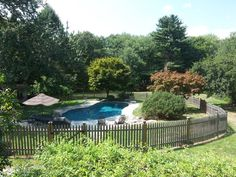 Lilac trees, rhododendron, forsythia, rose of sharon trees, Japanese maples, hydrangea bushes and evergreens adorn this property. The gunite pool features a surround patio of quartz and renovated pool cabana.