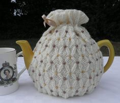 Beautiful hand knitted beaded tea cosy in a variety by TeabeaKnits