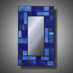 Hey, I found this really awesome Etsy listing at https://www.etsy.com/listing/183340299/blue-stained-glass-mosaic-mirror-accent