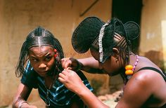 Africa   Traditional hairdressing among the Fula women of Futa. Guinea.   ©Julien Lecordier //