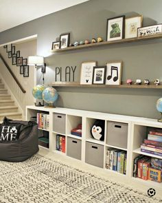 Home Interior Living Room HUGE empty wall transformed into pretty game and toy storage!Home Interior Living Room HUGE empty wall transformed into pretty game and toy storage! Ikea Toy Storage, Kids Storage, Ikea Cubbies, Wall Storage, Storage Hacks, Media Storage, Living Room Storage Ideas For Toys, Storage For Toys, Wall Shelves