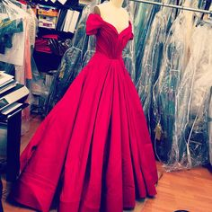 Royal red gown being worked in the studio today. The Fall collection will be in stores soon!