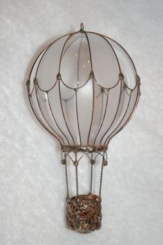 Hot air balloons made from recycled light bulbs. (This one is $115) Gorgeous! Lots more designs at the link.