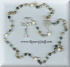 18-Inch Rhodium Plated Necklace with 6mm Ruby Birthstone Beads and Sterling Silver Saint John Vianney Charm.