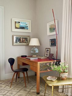 """We changed the dynamic of the enfilade by having a painted room, a plain fabric-covered room, a patterned room and a specialist paint-effect room,"" says Oliver. ""At a quick glance, it looks monochromatic. But in fact, each room has its own unique personality."" Vintage Italian desk. Custom lamp. VGA linen for curtains.   - Veranda.com"