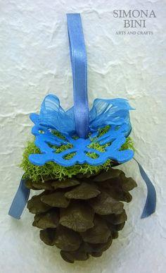 Pigna con farfalla e fiocchi azzurri