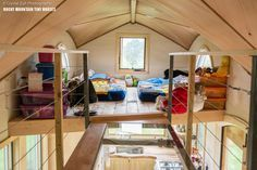 A 20′ tiny house on wheels built for a family of four with high-quality components in Durango, Colorado. The see-through walkway between the kids' loft and the adult loft is remarkable and brilliant. This walkway means you only need one staircase and nearly nothing to obstruct your view from top or bottom.