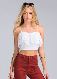 It's no surprise that you and the other fashionistas are obsessed with this eyelet peplum crop top. It's just that chic.