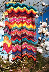 Colorful inventive lace knitting inspired by exotic tropical blooms in botanical gardens. *paid pattern*