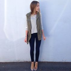 Utility cargo vest with striped top and ankle boots outfit idea