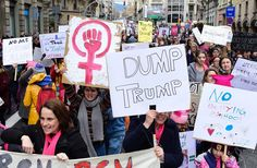People march holding placards in central Barcelona on January 21, 2017 in a mark of solidarity for the political rally promoting the rights and equality for women.