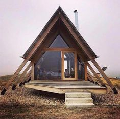 Untold adventures on the outside. Cozy on the inside. Live the glamping life in … - architecture house A Frame Cabin, A Frame House, Tiny House Cabin, Cabin Homes, Cabin Design, Tiny House Design, Casas Containers, Cabins In The Woods, Tiny Living