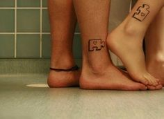 Puzzle couple tattoo