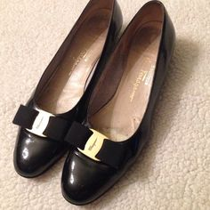 Ferragamo Black Bow Flats Ferragamo's signature piece! Black patent leather with gold ornament and thick ribbon bow. These are preloved and interior shows it while the exterior has minor scuffs. Narrow AA Salvatore Ferragamo Shoes Flats & Loafers