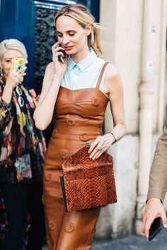 The colour of the dress mixed with the leather on the bag.