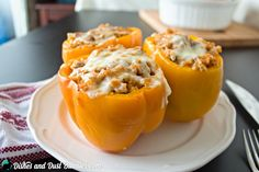 Chicken and Rice Stuffed Peppers from dishesanddustbunnies.com