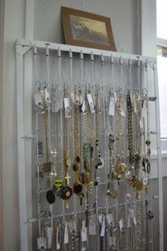 Re-purposed crib idea.  Could also be hung from the ceiling over a wood stove to dry clothes on hangers.