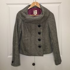 Tweed Blazer Jacket Jacket is a houndstooth pattern. tweed material on outside, beautiful purple silky liner on the inside. A series of buttons and snaps to fasten it up. Front pockets and buttons on the sleeves. Great condition. Tulle Jackets & Coats