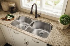 Accent your kitchen with the Moen Arbor kitchen faucet in oil rubbed bronze.