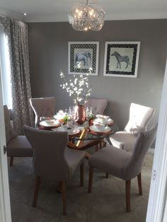 Safari theme animal dining room glass table wood greys soft pastel fabric chairs