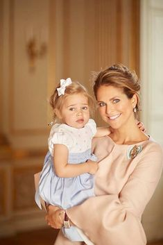 "Princess Madeleine posted photos on her Facebook page taken the day of the baptism of Prince Oscar: ""My sister and I are blessed as a small two adorable daughters of mothers who adore."""