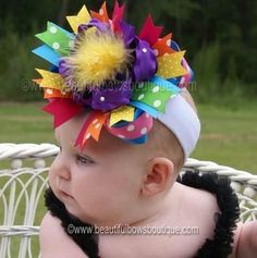 A big rainbow hair bowthat gives the Bird of Paradise flower a run for its money! Attention grabbing color bursts to life on baby's head in this vibrant hair accessory tha... #handmade #etsy #bighairbows #overthetop #boutique #babygirl #1stbirthday #babyclothes #hairbows #hair-bows #over-the-top-hair-bows ➡️…