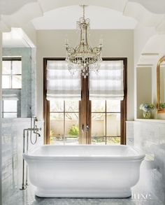 If you have a first-floor bathroom, consider french doors in your master bathroom instead of a window. I love how this designer exquisitely framed up the view with the intricate arch and freestanding tub. See other Master Bathtub Ideas. Mediterranean Bathroom, Contemporary Interior Design, Luxe Interiors, Bathroom Decor, Luxury Bathroom Master Baths, Bathrooms Remodel, Beautiful Bathrooms, Luxury Bathroom, Bathroom Design