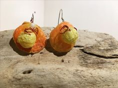 SE02 $15 Thorny scallop and leafy jewel box shells with orange wire accent. Sterling silver ear wires.