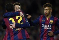 Barcelona's Argentinian forward Lionel Messi (C), Barcelona's Brazilian forward Neymar da Silva Santos Junior (R) and Barcelona's midfielder Rafinha (L) celebrate after scoring a goal during the Spanish league football match FC Barcelona vs Villarreal CF at the Camp Nou stadium in Barcelona on February 1, 2015.