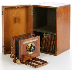 "Antique Camera: The Mignon Bicyclists' Camera (c.1886) is a very small American field camera (front focusing pattern) making 3¼"" x 4¼"" images on glass plates. It was listed in catalogues from about 1885 into the early 1890s. This appears to be the only known example. Price of a complete ""photo-outfit"" (lens, universal joint bicycle attachment and canvas saddle bag) was $70 in 1886."