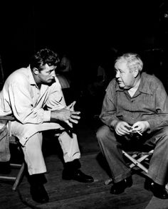 """Robert Mitchum and director Charles Laughton on the set of """"The Night of the Hunter"""", 1955"""
