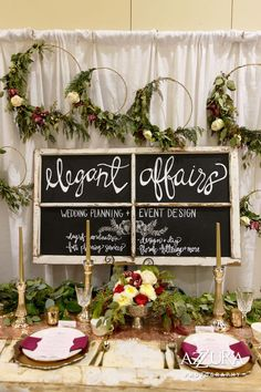 Wedding Show Booth that gives off an elegant vibe. Gold and burgundy give a rich feeling to the space and the setup helps brides imagine the head table.