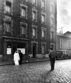 'La Sricte Intimite' by Robert Doisneau (© Robert Doisneau). I love the exposure in this image. The range of tones is incredible. The highlights and whiteness of the wedding dress have been 'pushed' just far enough to still retain details. To analyze using Ansel Adam's zone system, it would sit in zone 9. The blacks are pure. Although the light is quite soft as is seen in the gradation of the shadows, Doisneau has achieved a beautiful high tonal contrast in this photograph.