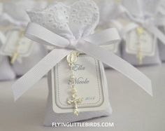 """Size: Approximately 3.5"""" x 2.5"""" Scent: Lavender Personalised tag with name & date Detail of finishing: Small Rosary Color: White fabric, white"""