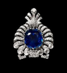 Turban Ornament or Brooch of the Maharaja of Nawanagar, circa 1920, modified circa 1925-1935, India. Platinum, set with sapphire and diamonds, 3 inches, via The Al-Thani Collection.