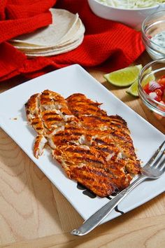 Chipotle Lime Fish Tacos: 1 pound white fish such as tilapia, cod, etc. 2 tablespoons oil 1 lime, juice 1 tablespoon chipotle chili powder 1 teaspoon cumin, toasted and ground salt and pepper to taste 8 (4 inch) corn tortillas