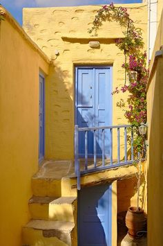 Doors and Steps.Narrow streets & houses of Ano Syros, Syros Island , Greek Cyclades Islands Photo Wall Collage, Picture Wall, Mellow Yellow, Blue Yellow, Street House, Belle Villa, Yellow Walls, Windows And Doors, Aesthetic Wallpapers