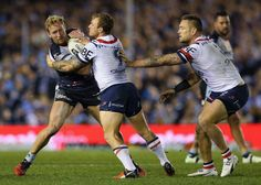 Jake Friend Photos Photos - Matt Prior of the Sharks is tackled by Jake Friend…