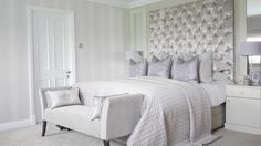 Luxurious chic bedroom with velvet buttoned headboard and bespoke bench, designed and fitted by Atlas interiors