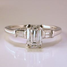 Solitaire 0.90 carat t.w. emerald-cut diamond  14-carat white gold engagement ring  found on Ruby Lane