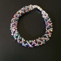 Beautiful holographic beaded bracelet Intricately beaded beaded bracelet with a strong magnetic clasp. Bought years ago from a street vendor in NYC Chinatown. Jewelry Bracelets