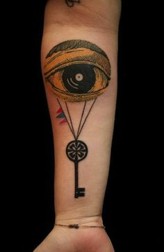 Eye balloon and key tattoos