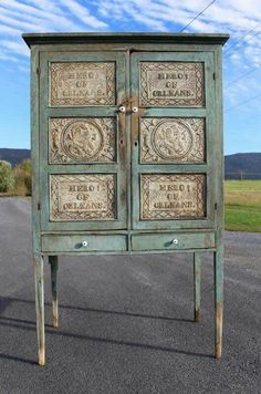 Blue punched tin pie safe
