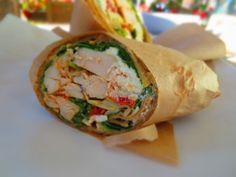 Mediterranean Chicken wrap on a gluten free tortilla- grilled chicken + house made hummus + feta + fresh basil + artichoke hearts + sundried tomatoes + spinach + herb & garlic