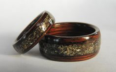 This is a bentwood ring set in wenge with beach sand inlays. The sand came from the Eastern United States coast, and it is a gray sand with multicolored shell and quartz material. The rings pictured above are 9mm wide and 5mm wide, however you may choose widths to suit your taste. We can also make other modifications upon your request. Wenge is the type of exotic hardwood we used to create this set. These rings would be perfect for a beach wedding or ceremony.  Please choose Ring 1 Size and…
